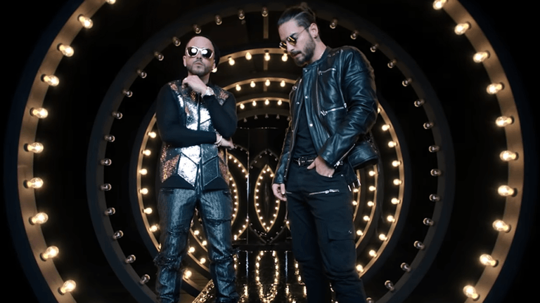 http://cinemagiants.coyotemediahouse.com/wp-content/uploads/2020/12/04Solo-mia-Yandel-Maluma-768x432-1.png