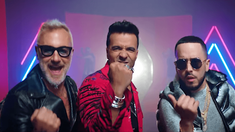 http://cinemagiants.coyotemediahouse.com/wp-content/uploads/2020/12/Gianluca-Vacchi-Luis-Fonsi-Sigamos-Bailando-ft.-Yandel-768x432-1.png